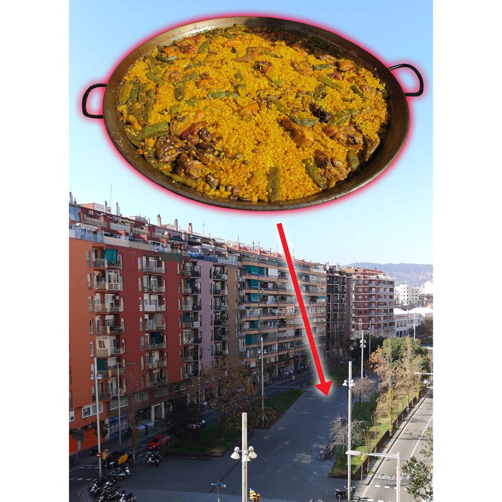 Paella de verdures, segons l'autèntica recepta valenciana, cuinada per professionals al bell mig de la rambla.
